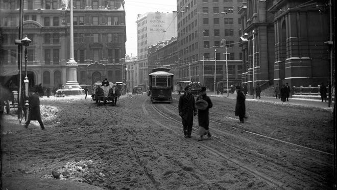Here is Post Office Square as it was during the winter of 1916. Notice the horse drawn wagon and trolley #91. Nearby are the New England Mutual Life Insurance Building, Angel Memorial Park and the Post Office.