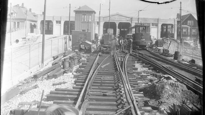 Workers repair the tracks at Fields Corner in 1927. Learn more from Digital Commonwealth at www.digitalcommonwealth.org.