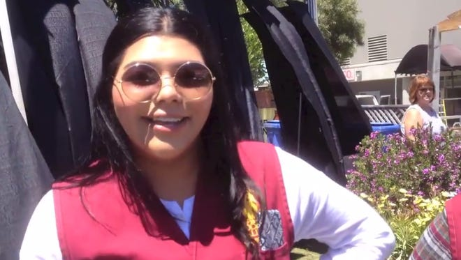 Yulie Palomares, from Salinas High School, is one of the many young volunteers at the California Rodeo Salinas this year.