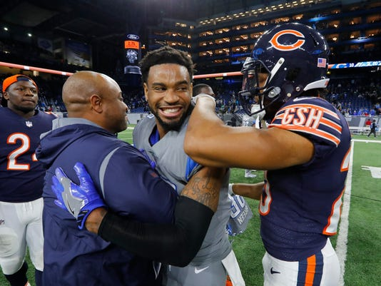 Detroit Lions cornerback Darius Slay (23) is greeted by Chicago Bears cornerback Kyle Fuller, right, after an NFL football game, Saturday, Dec. 16, 2017, in Detroit. (AP Photo/Paul Sancya)