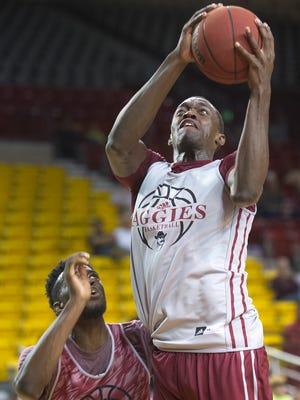 New Mexico State's Pascal Siakam, right, will be a key part of the Aggies' offense this season. Siakam is the Preseason Western Athletic Conference Player of the Year.