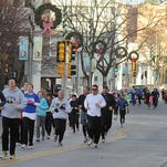 Participants make their way down Phillips Avenue in downtown Sioux Falls in a past Run for Food on Thanksgiving Day.