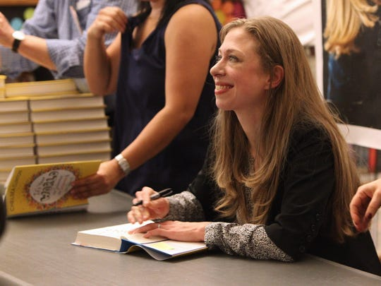"Chelsea Clinton signs copies of her book, ""It's Your World"" at the Chappaqua Library Sept. 30, 2015."