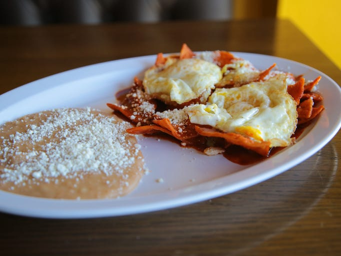 Chilaquiles con salsa roja are part of a popular brunch