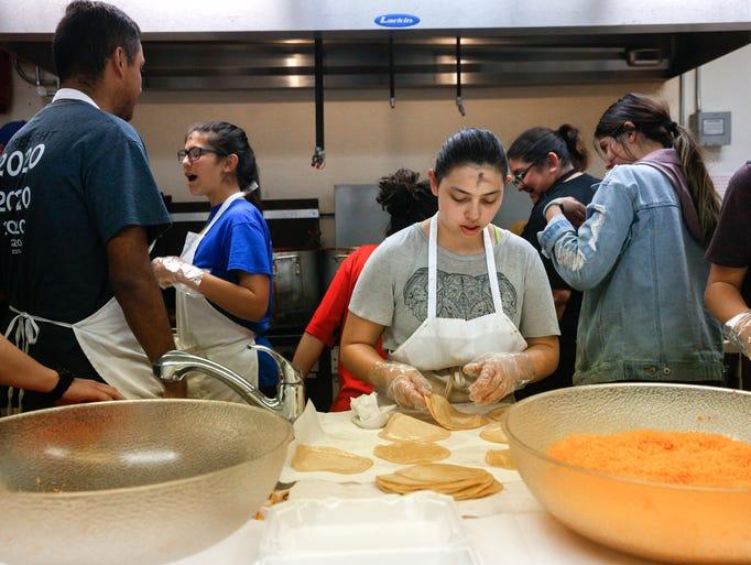 Emilie Gallegos, center, prepares tortillas on Wednesday