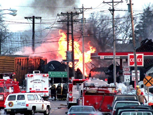 Emergency personnel rush to the scene of a train derailment and fire in Weyauwega on March 4, 1996. Authorities soon would realize the danger and evacuate the city.