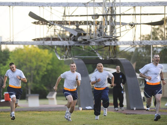 Officer trainees run wind sprints at the Wright Flyer