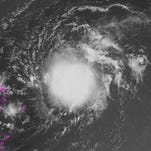 A satellite image taken Wednesday morning Aug. 26, 2015, shows Tropical Storm Erika spinning east of the Caribbean's Leeward Islands.