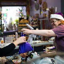 Michele Boyle, of Binghamton, browses inside the Garland Gallery in downtown Binghamton on Small Business Saturday.