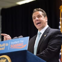 Gov. Andrew Cuomo on Wednesday announced  the state is awarding $20 million from the Upstate Revitalization Initiative for Binghamton University flexible technology research. On Cuomo's lectern is the new name for the economic development program, Southern Tier Soaring.