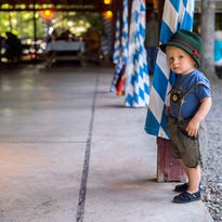 Charlie Ehmke, 1, of Town of Chenango, takes in some traditional German music at the Sommer Biergarten Festival at the Binghamton German Club on Saturday, July 23.