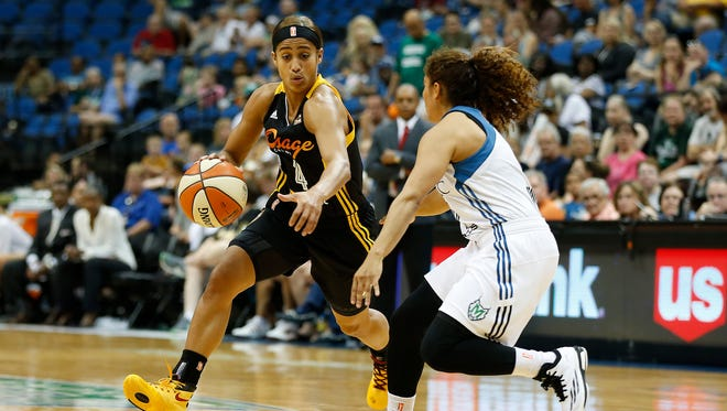 Tulsa Shock guard Skylar Diggins (4) drives the ball around Minnesota Lynx's guard Jennifer O'Neill during the first half of a WNBA basketball game, Sunday, June 21, 2015, in Minneapolis. Tulsa won 86-78.