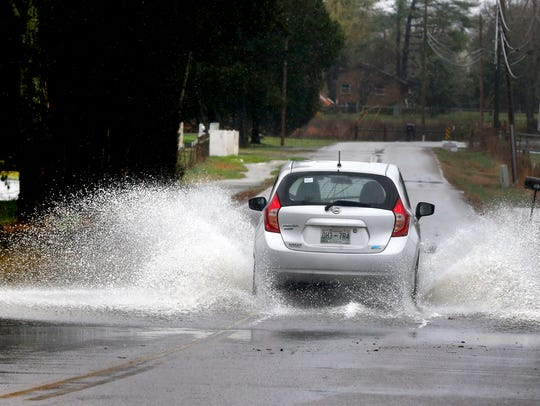 Residents should not attempt to drive on roads with standing water.