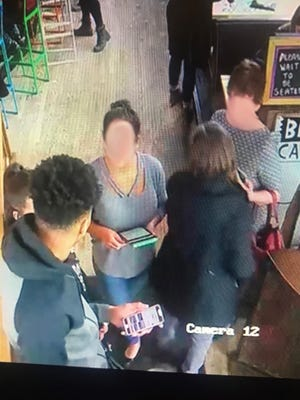 In this surveillance camera photo released by BelAir Cantina, a manager greets Giannis Antetokounmpo of the Bucks after he walks in for a post-game meal April 22.