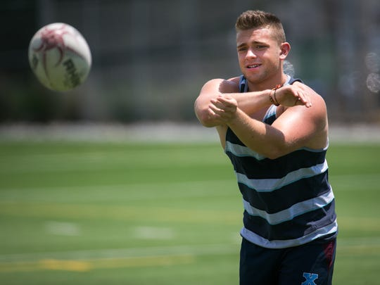 Nick Jimenez warms up at Frazer Field as the UD Men's Rugby Club practice for this weekend's College Championships in Philadelphia.