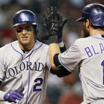Colorado Rockies Troy Tulowitzki (2) celebrates with Charlie Blackmon after hitting a three-run home run against the Arizona Diamondbacks in the first inning during a baseball game Sunday in Phoenix.