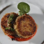 The Crab Cakes dish created by chef Paul Fehribach of the Big Jones restaurant in Chicago. June 24, 2015