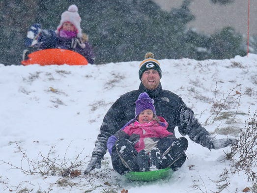 Paul Fearday, of Whitefish Bay, (sled rear) and his