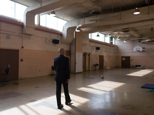 Detroit School District Superintendent Nikolai Vitti walks through an unused gym on Wednesday, May 9, 2018 at Henry Ford High School in Detroit.