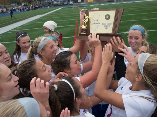 Wall celelbrates with their State Championship trophy. Wall Girls Soccer defeats Westwood Regional in onetime during the  NJSIAA Girls Group II State Soccer Championship final at Kean University on November 18, 2017.