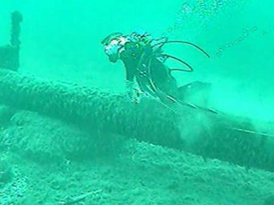 Enbridge says its Pipeline 5 -carries millions of gallons of oil and natural gas each day  under the Mackinac Straits.This photo filmed last summer shows a diver inspecting the 62-year-old pipleline.