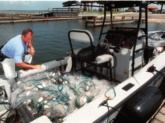 File photo shows an illegal 12,000-square-foot gill net that was confiscated by officers in 1999. After a short grace period,