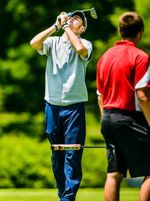 Owen Rush of Lansing Catholic reacts after a putt on the 15th green in the first round of the Division 3 finals Friday June 10, 2016 at Forest Akers East in East Lansing.  Despite the mishap on 15, Rush finished with a 72, tied for 2nd.