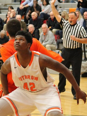 Withrow senior Calvin English executes the block out for the Tigers at the free throw line.