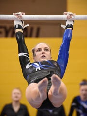 Sartell's Ali Hess competes on the uneven parallel bars during the team Class A championships Friday, Feb. 23, at the Maturi Pavilion in Minneapolis.