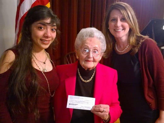 Jean Klatchko, Chairman, Woman's Club of Lebanon Memorial Educational and Historical Preservation Trust Fund, presents a $5,000 check to Kattya Palacios, a current student attending college with help of a scholarship from the Lebanon Valley Education Partnership. Also pictured is Jamie Cecil, Director of Development, LVC.