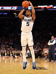 Villanova Wildcats guard Phil Booth launches a jumper.