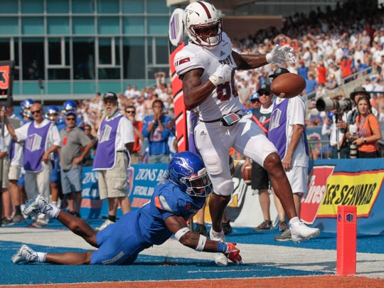 Boise State linebacker Desmond Williams strips the ball from Troy wide receiver Deondre Douglas (80) just before the goal line during the second half of an NCAA college football game in Boise, Idaho, on Saturday, Sept. 2, 2017. Boise State won 24-17. (AP Photo/Otto Kitsinger)