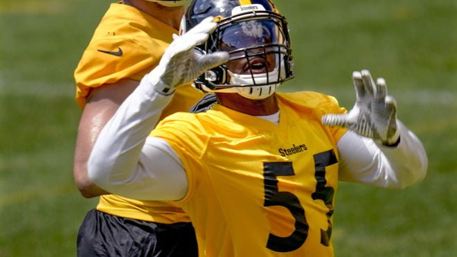 Pittsburgh Steelers linebackers Devin Bush (55) and Robert Spillane participate in a drill during practice at NFL football training camp Wednesday in Pittsburgh. Bush, the Steelers' second-year linebacker, says he believes the NFL game is slowing down for him and that should allow him to play faster after a solid and occasionally spectacular rookie season.
