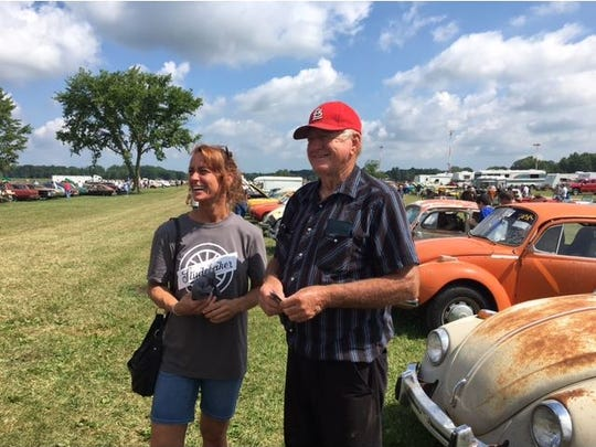 Here, Ron Hackenberger and daughter Carla, talk with visitors at Friday's preview of the weekend auction of Hackenberger's collection of 700 cars.