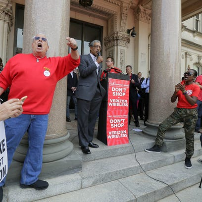 State Sen. Ronald Rice speaks as unions striking against