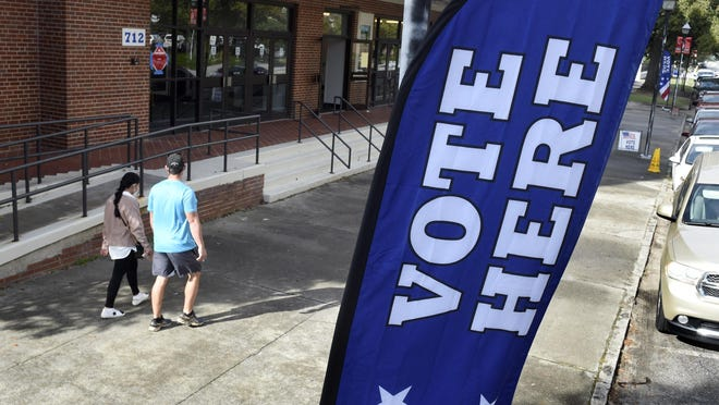 Voters head for the Bell Auditorium to cast their ballots during advance voting in Augusta, Ga., Wednesday morning October 28, 2020.