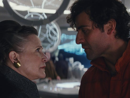 General Leia Organa (Carrie Fisher, left) gives an