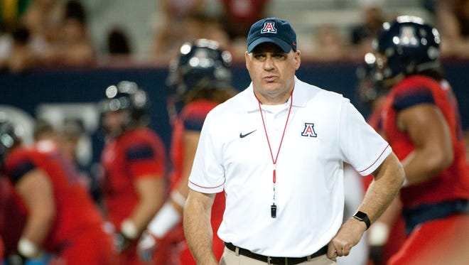 Oct 29, 2016: Arizona Wildcats head coach Rich Rodriguez stands on the field during warm ups before the game against the Stanford Cardinal at Arizona Stadium.