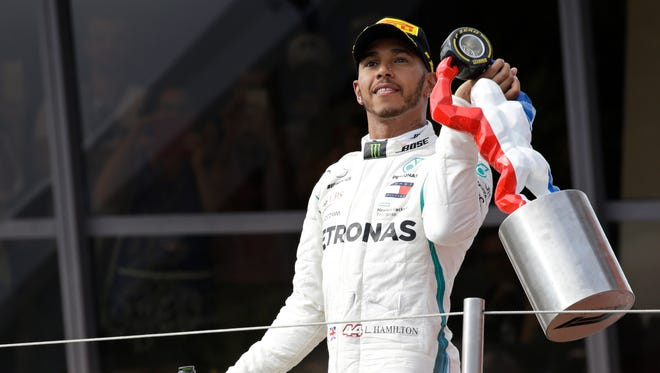 Lewis Hamilton leaves the podium with his trophy after winning the French Grand Prix Sunday in Le Castellet, France.