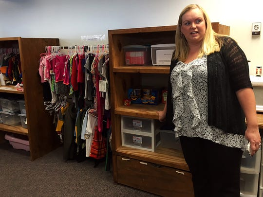 Tabitha Aleshire with Children's Division shows the small collection of new clothes and snacks they can give kids as they are entering foster care.
