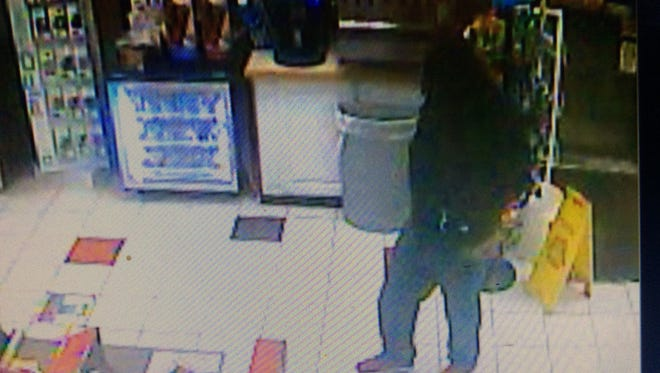 Police released this surveillance photo of the suspect in a Saturday night robbery at the Champlain Farms convenience store on Main Street in Burlington, Dec. 10, 2016.