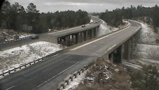 Snow dusts the ground along Interstate 40 just west of Flagstaff on March 29, 2016.