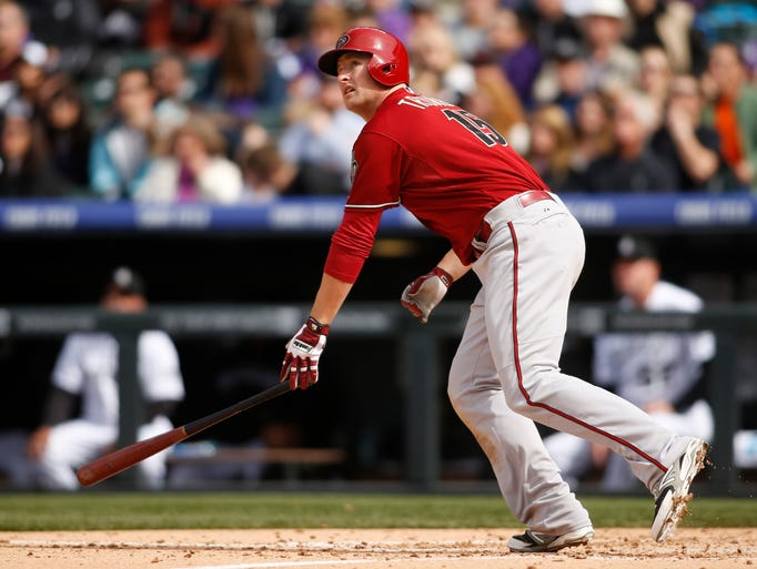 Arizona Diamondbacks left fielder Mark Trumbo (15) hits a home run during the fifth inning against the Colorado Rockies at Coors Field on April 6, 2014.