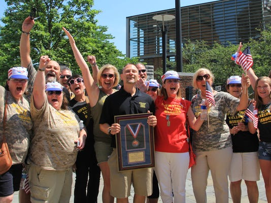 636348661668617310-Yellow-Ribbon-of-S.-Jersey-volunteers-celebrate-at-news-of-50-000-Wawa-grant.jpg