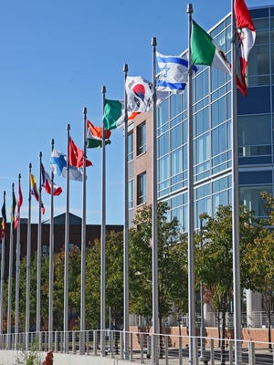 The flags of many nations fly in front of ManpowerGroup's downtown Milwaukee offices.