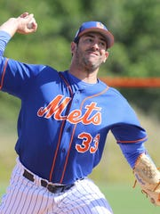 Matt Harvey throws a pitch earlier in camp.