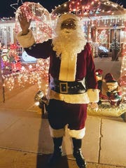 Dan Ortega, who resides at 400 Cuba Avenue, dressed up as Santa Claus and passed out candy to children this Christmas Eve Saturday, Dec. 24.