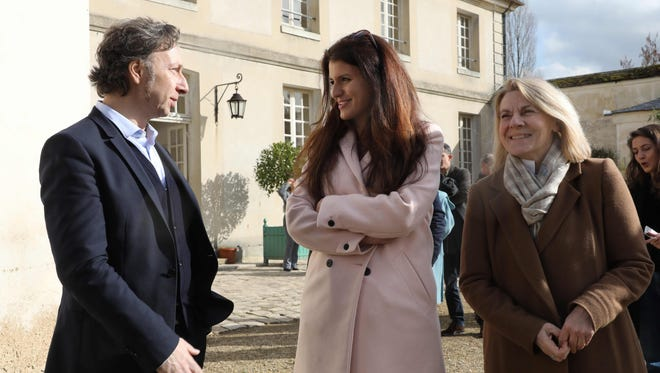 French journalist Stephane Bern (left) speaks with French Junior Minister for Gender Equality Marlene Schiappa (center) and President of The National Estate of Versailles Catherine Pegard in Versailles, near Paris, on Feb. 16, 2018.