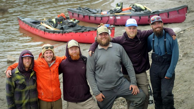 Four Minnesotans and a pair of Iowans made a brief stop Wednesday in Mankato before resuming their 5,200 mile canoe trip from the Gulf of Mexico to the Arctic Ocean. From left are Jarrad Moore, Luke Kimmes, Adam Trigg, John Keaveny, Dan Flynn and Winchell Delano.