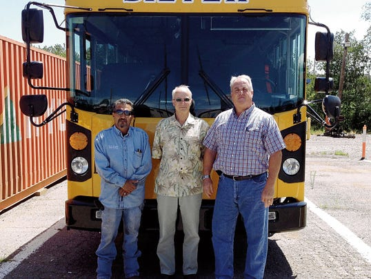 Bus maintenance superivsor Johnny Ortiz, from left, Barry Ward, director of facilities and business office supervisor, and Gus Benakis, associate superintendent for human resources and transportation, prepare for the new school year on Tuesday at Silver Consolidated Schools. Shannon Seyler - Sun-News